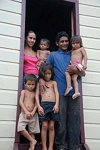 Dona Maria and family on the steps of their new home