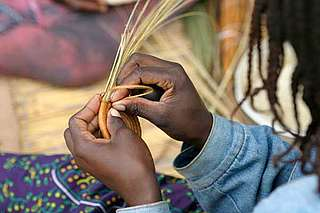 Woman making handicraft goods, Namibia