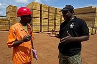 Joseph, sawmill manager, talking to Alphonse, WWF Cameroon, at Alpicam logging company, Kika, East province, Cameroon