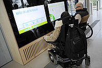 Wheelchair users looking at the screens in the WWF Experience