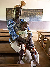 Teacher Adekon Sebastien and her daughter Marie Segolene inside the school building in Malene village, East province, Cameroon