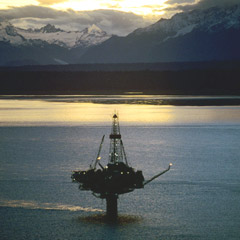 Twilight view of oil rig off coast of Alaska, United States.