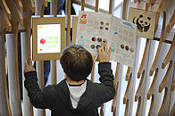 Child enjoying the treasure hunt in the WWF Experience at the Living Planet Centre