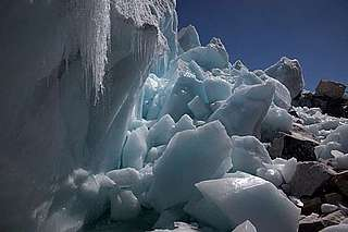 Water dripping from the melting ice on the Khumbu Glacier at the foot of Mount Everest in the Himalayas, Nepal.