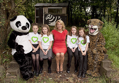 Megan, Rebecca, Freya and Rosa winners of the young reporters competition posing with Lorna Dunkley, panda and jaguar