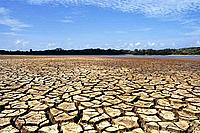 Cracked soil and blue sky, Ilha do Caju, Brazil