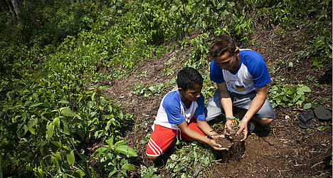 Two school children inspect soil quality in Acre, Brazil.
