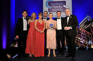 The HSBC Climate Partnership (HSBC, WWF, Earthwatch, Smithsonian and The Climate Group) was awarded the Charity Partnership Award (Financial and Professional) - for contributions to reducing the impact of climate change on people, forests, freshwater and cities - at the Business Charity Awards 2012 (with compere Huw Edwards)