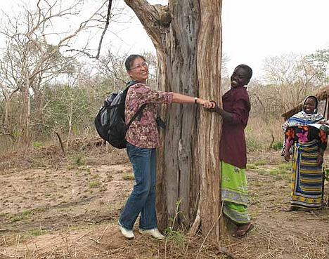 Women encircling tree