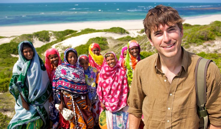Simon Reeve with locals on the island of Kiwayu, northern Kenya.  © ANDREW CARTER