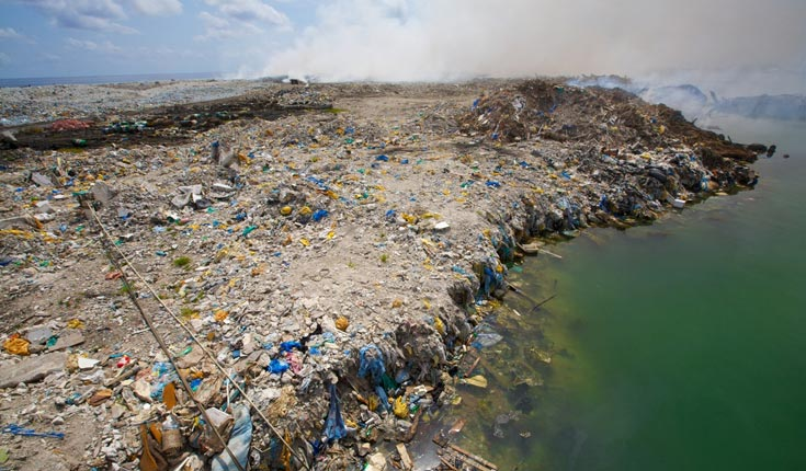 An extraordinary rubbish island in the Maldives.  © Simon Reeve / BBC