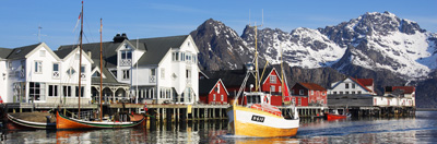 Fishing boat arriving back into port in Henningsvaer, Lofoten Islands, Norway