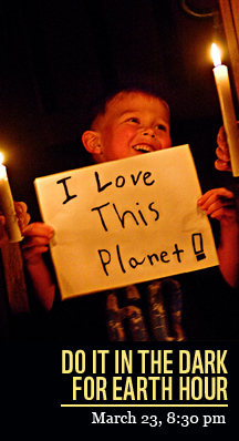 Young boy holding a poster that says I love this Planet - for Earth Hour