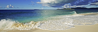 Beach scene and clouds over the ocean.  Cousine Island, Seychelles