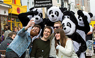 Supporters taking a Team Panda selfie at the Brighton Marathon