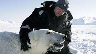 Researcher with polar bear