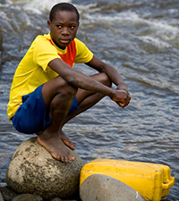 A boy collecting water