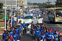 Protesters march through the streets of Brasilia in opposition to forest law changes.