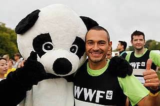 Royal Parks Half Marathon 2011, WWF runner with Panda.