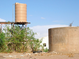 Protected water container and cemented water tank to avoid destruction by elephants. © Jo Benn /WWF-Canon