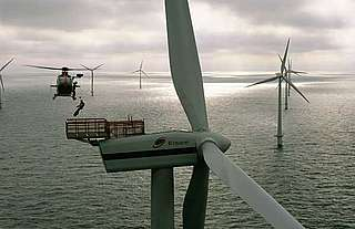 A helicopter lowering a technician to maintain the Horns Rev wind farm, Esbjerg, Denmark.