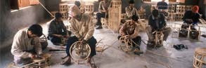 Local men attending a workshop organized by TAL in Khata, learning to manufacture furniture.