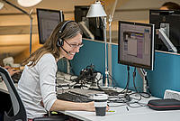 A staff member at her desk at the Living Planet Centre on the phone